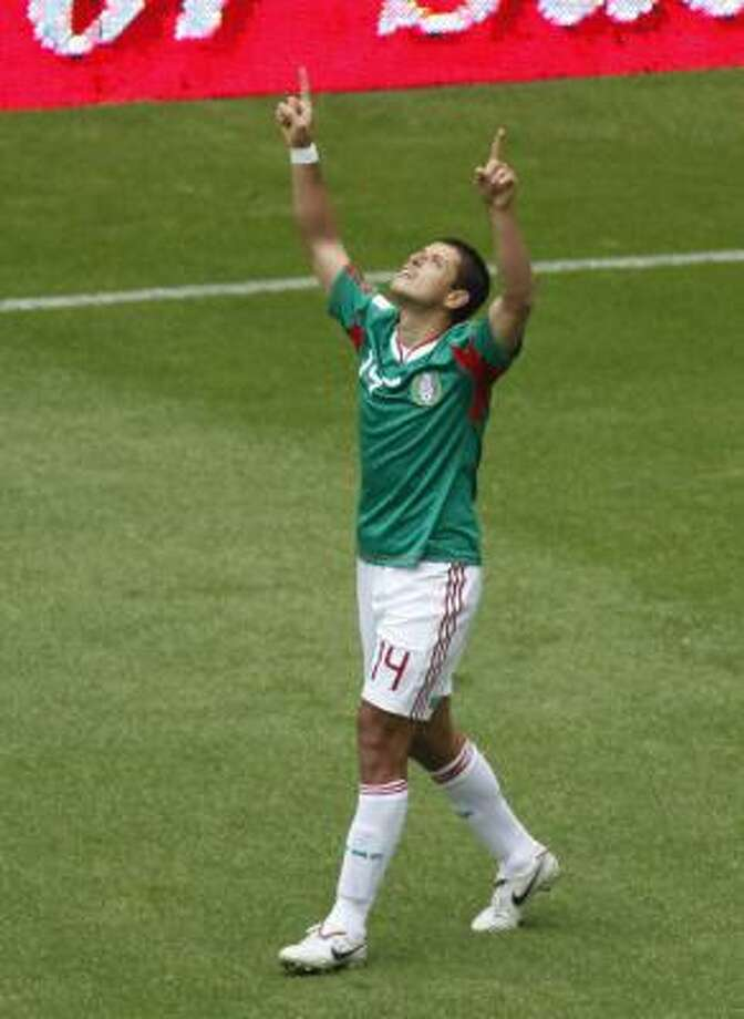 Mexico's Javier Hernandez celebrates his goal against Spain in Mexico City. Photo: Eduardo Verdugo, AP