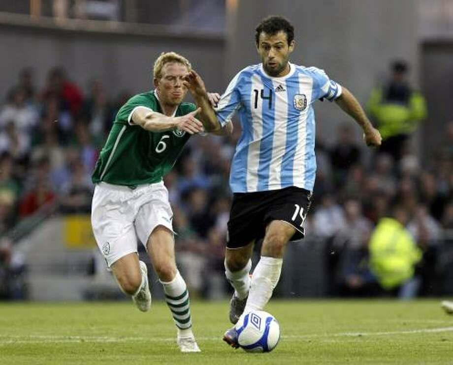Argentina's Javier Mascherano, right, wins the ball away from Republic of Ireland's Paul Green. Photo: Peter Morrison, AP