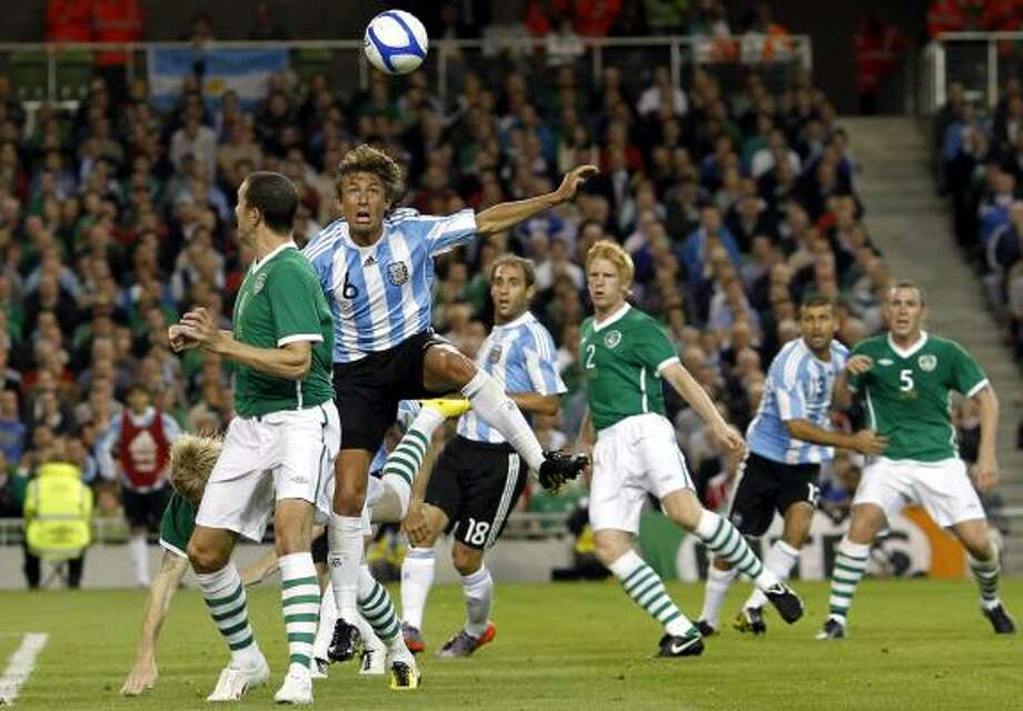 Argentina's Gabriel Heinze, second left, wins the header over Ireland's John O'Shea. Photo: Peter Morrison, AP
