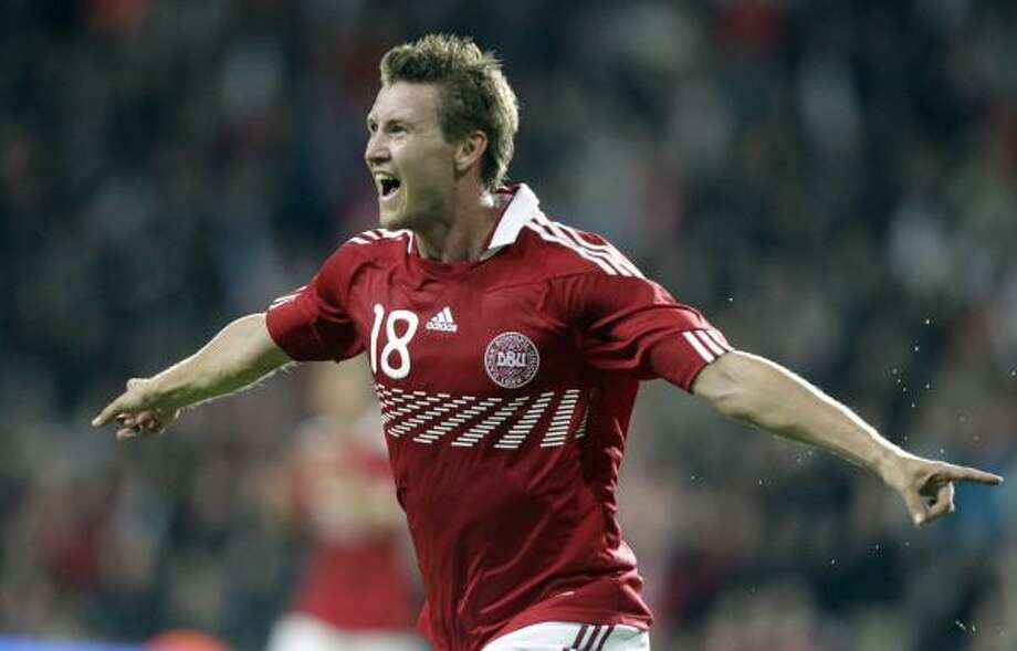 Denmark's Mads Junker celebrates after scoring to tie the game at 2-2 in the 87th minute.. Photo: Frank Augstein, AP