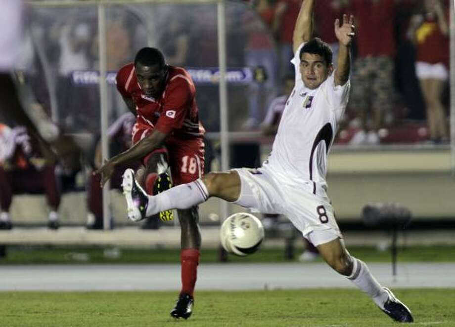 PANAMA 3, VENEZUELA 1 Venezuela's Tomas Rincon, Right, tried to block the shot of Panama's Luis Tejada in Panama City. Photo: Arnulfo Franco, AP