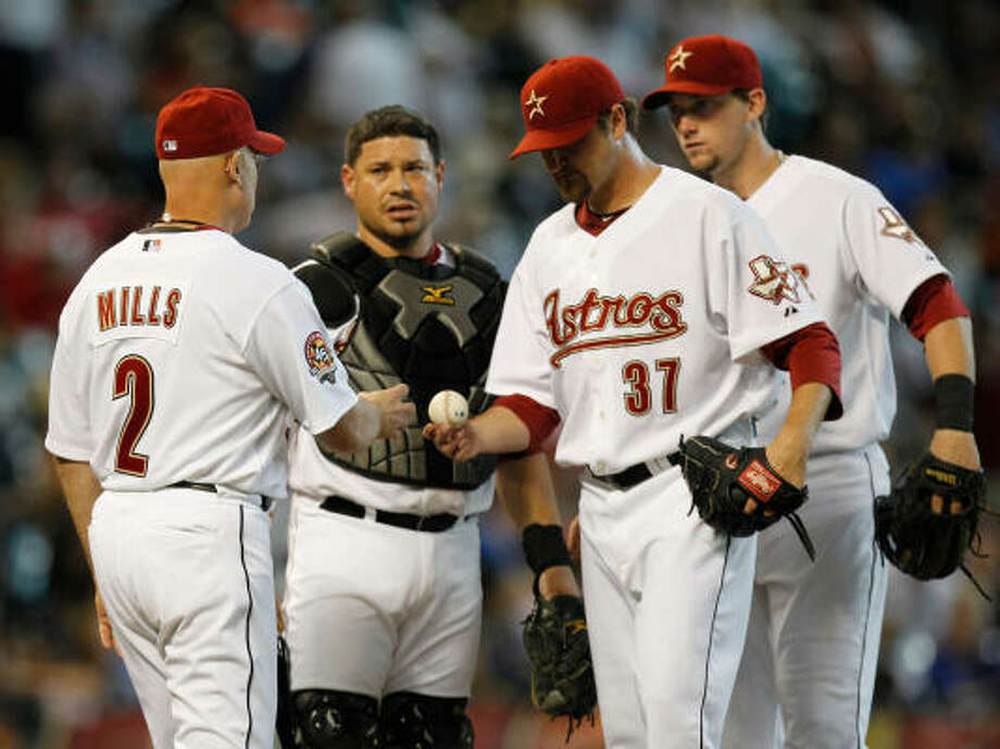 Aug. 11: Braves 8, Astros 2 (10 inn.)Astros manager Brad Mills, left, pulls reliever Brandon Lyon (37) in the 10th inning as catcher Humberto Quintero and third baseman Chris Johnson wait on the mound. Lyon was charged with five runs in that frame. Photo: Melissa Phillip, Chronicle