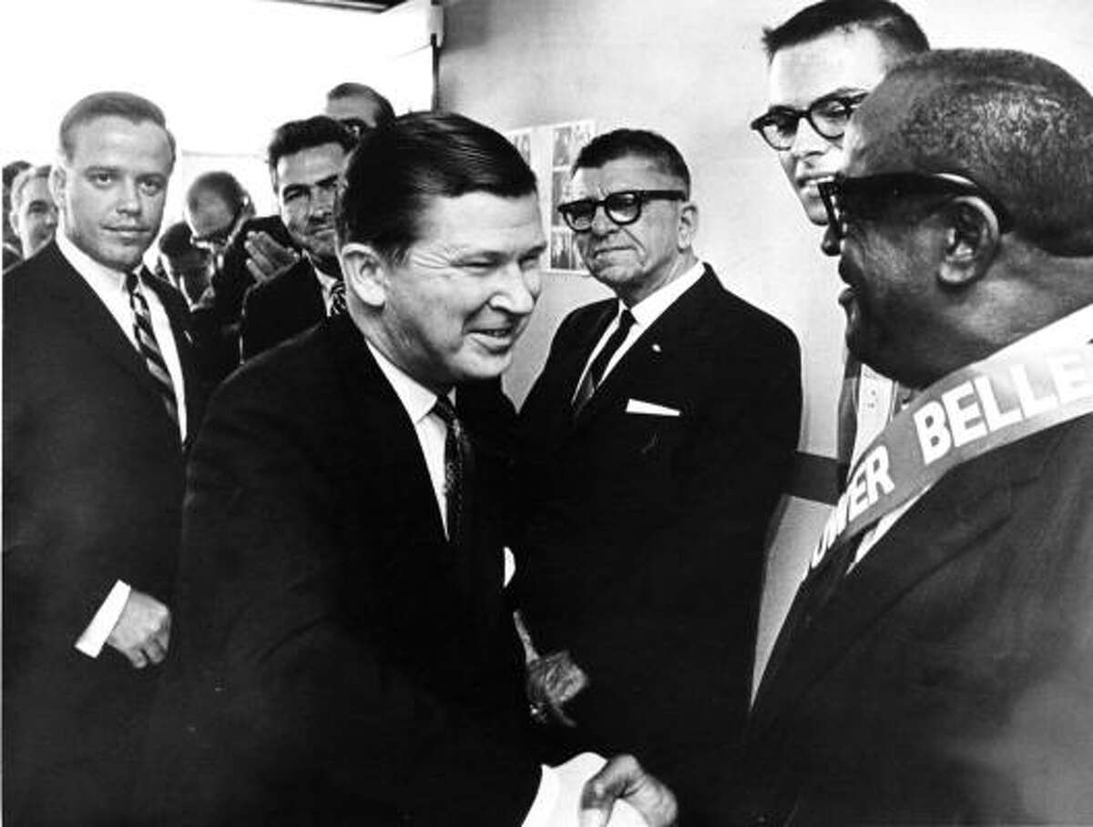 U.S. Sen. John Tower, left, greets a supporter in Houston on Sept. 29, 1966. Tower, who headed the Iran-Contra Affair investigation for President Reagan, was killed in a plane crash near Brunswick, Ga., in 1991. Also killed were his daughter Marian and astronaut Sonny Carter. Tower was a Houston native.