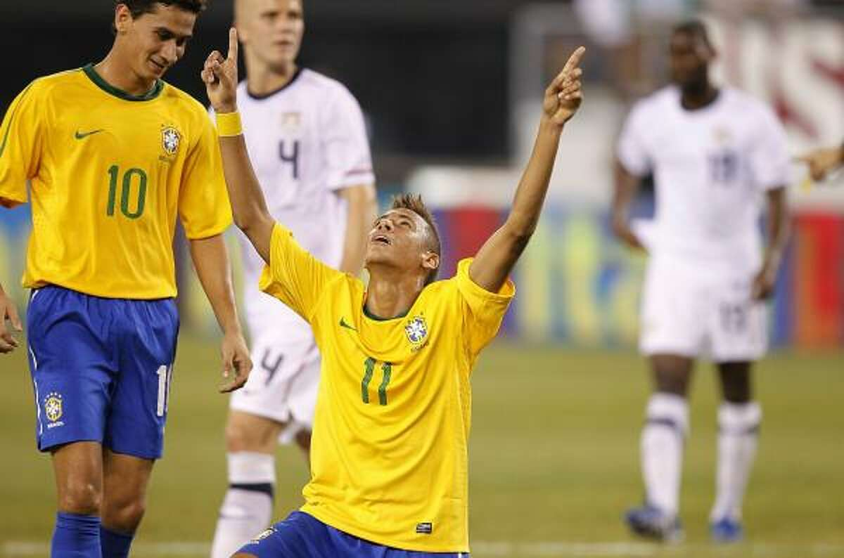 Brazil's Neymar (11) and Paulo Henrique Ganso celebrate after Neymar's goal against the U.S. in the first half of a Tuesday's friendly match in East Rutherford, N.J. Brazil won 2-0.