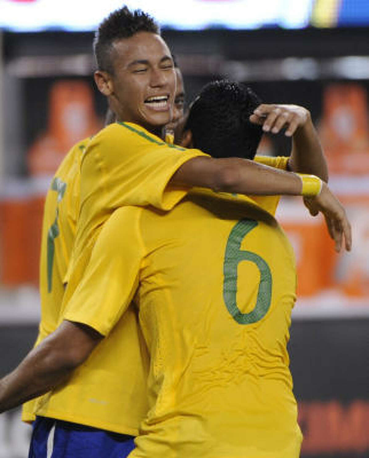 Brazil midfielder Neymar, left, celebrates his first-half goal with teammate Andre Santos during Tuesday's match against the U.S.