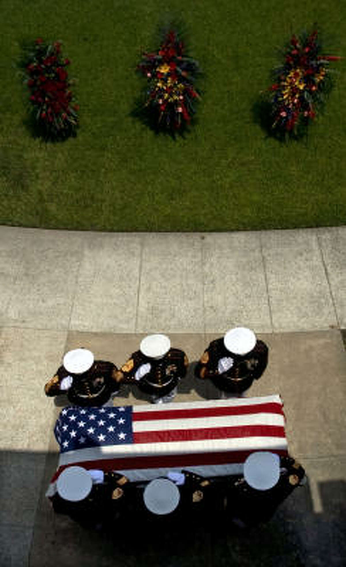 Marine Corps Color guard salutes the casket. Lance Cpl. Martin, with the 1st Light Armored Reconnaissance Battalion based in Camp Pendleton, died while on patrol in Helmand Province, Afghanistan.