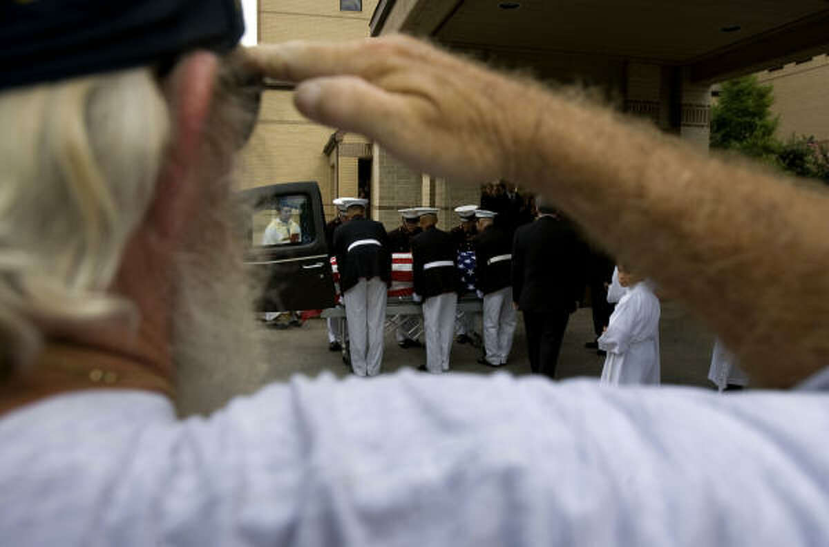 A Patriot Guard Rider salutes as the casket was loaded into a hearse after funeral services. Martin was born in Durban, South Africa and lived in Kenya and South Africa, before moving to Texas where he attended Klein Collins High School.