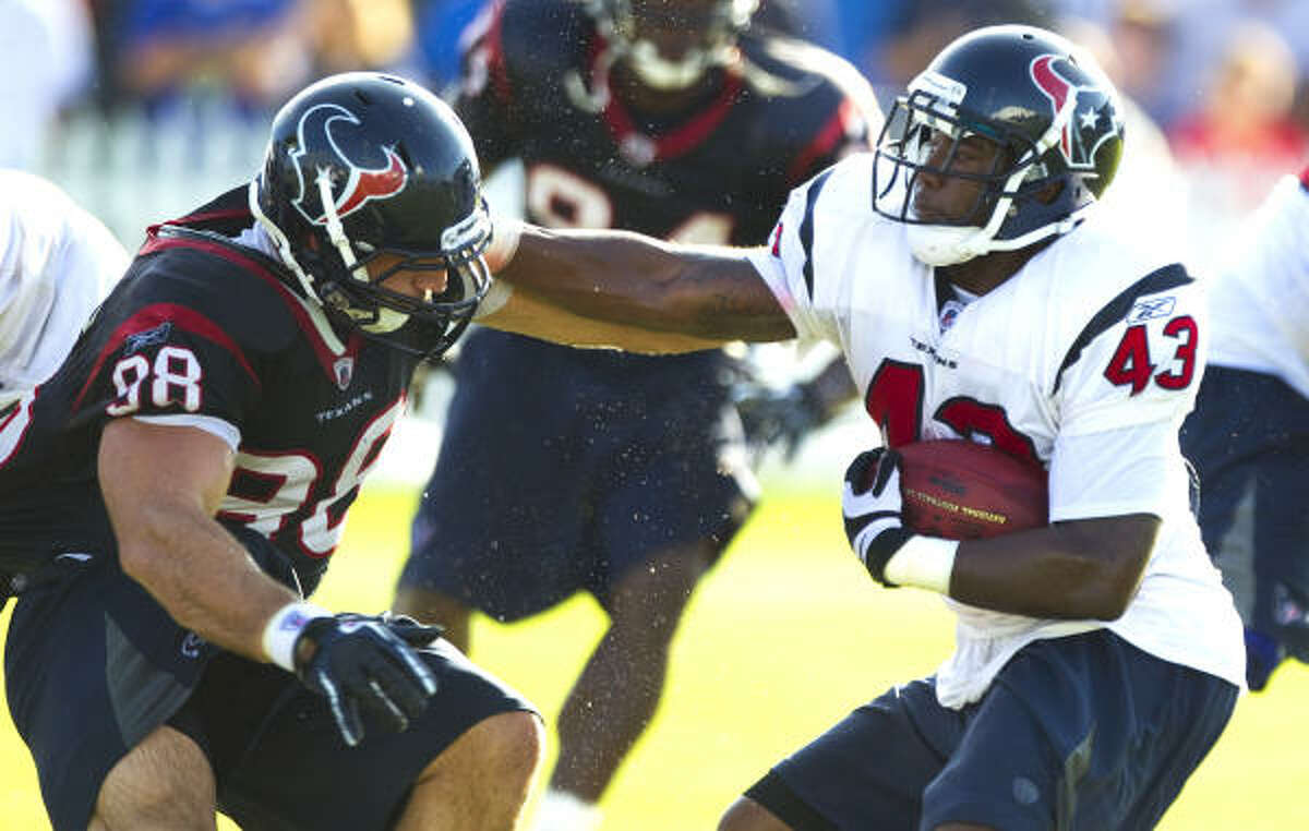 Texans running back Ben Tate (43) is confronted by defensive end Connor Barwin on a run.