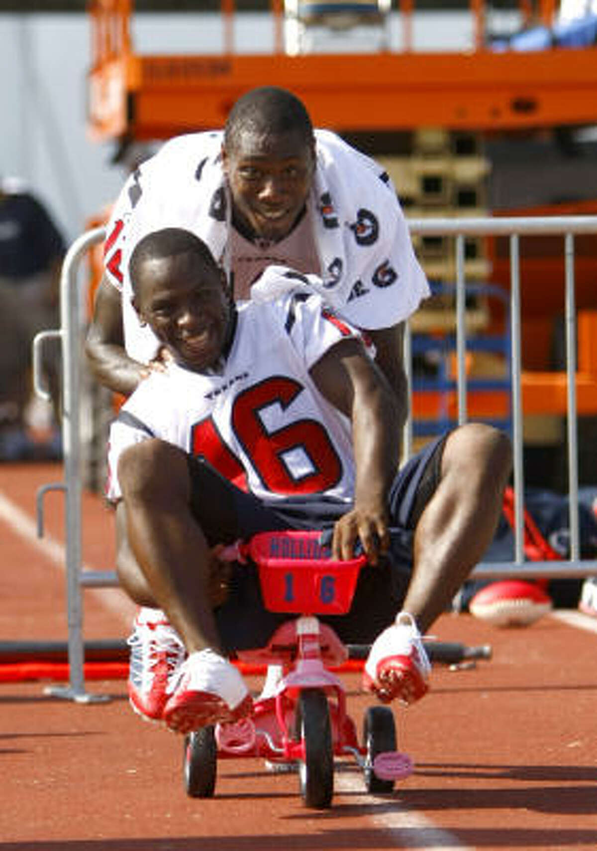 Texans rookie receiver Trindon Holliday, a sixth-round pick who is 5-foot-5 and 160 pounds, had his dose of hazing when several veterans joked he was too small for the stationary bikes that injured players ride during practice. On Aug. 4, a pink tricycle had Holliday's name and number on it, right next to the stationary bikes. After practice, Holliday was a good sport by getting on the tricycle and letting receiver Jacoby Jones wheel him around.