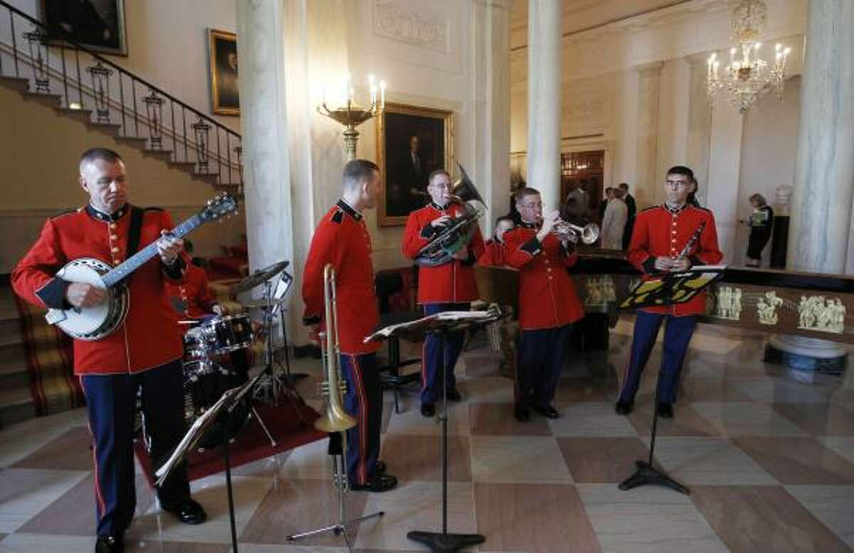 The President's Own Marine Band plays jazz music in the Grand Foyer of the White House.