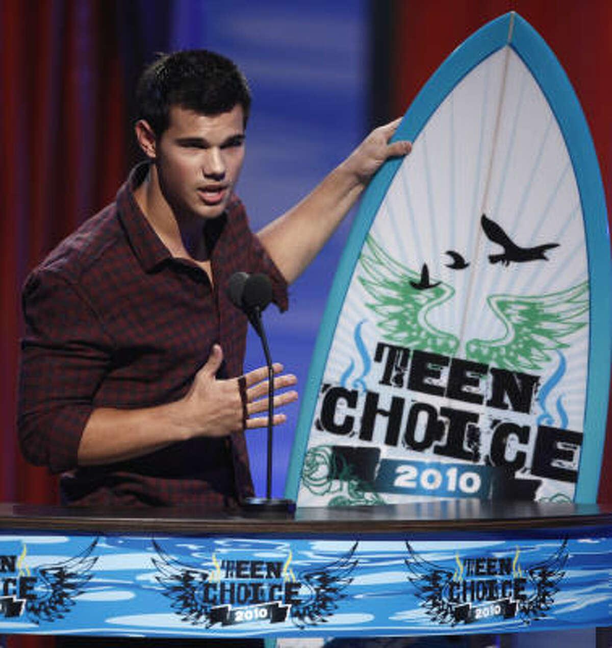 Twilight 's Taylor Lautner got serious when he won the best smile award.