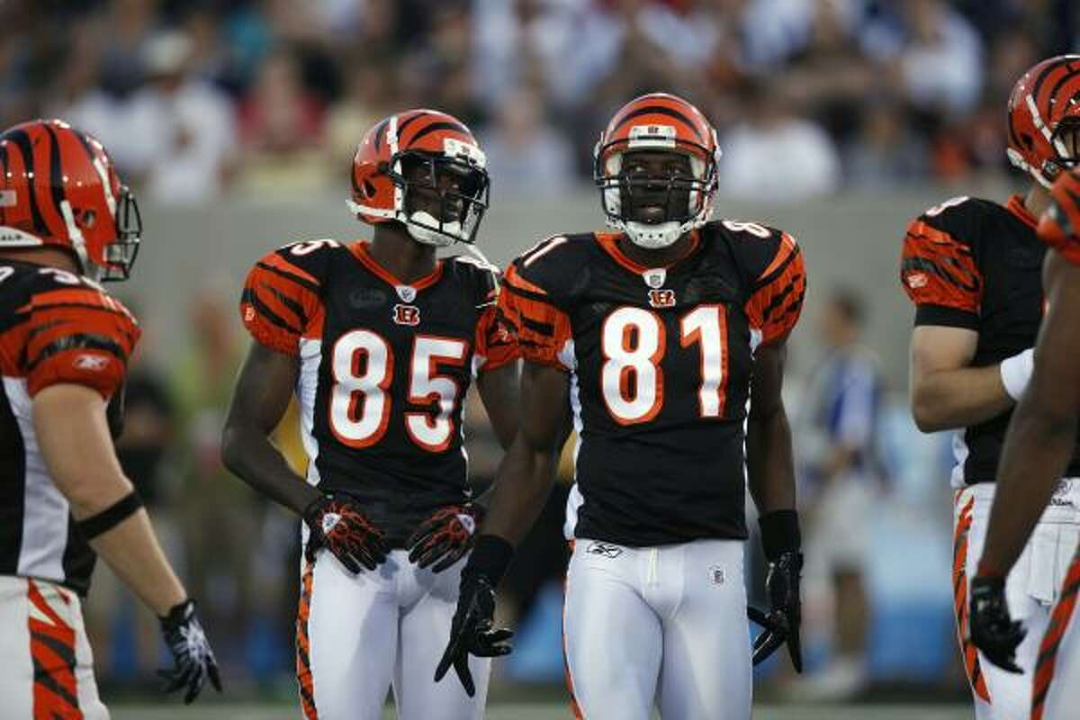 Bengals receivers Chad Ochocinco, left, and Terrell Owens take the field.