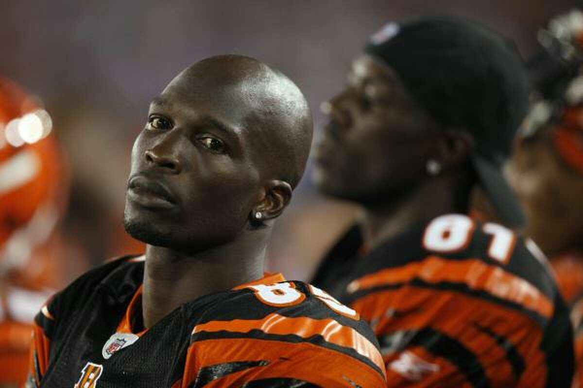 Chad Ochocinco, left, and Terrell Owens look on against the Dallas Cowboys.