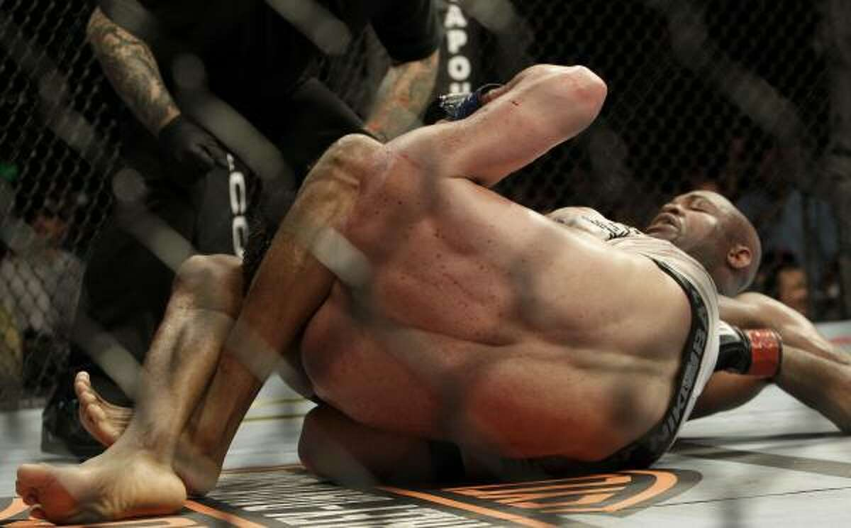 Anderson Silva, right, submits Chael Sonnen in the fifth round.