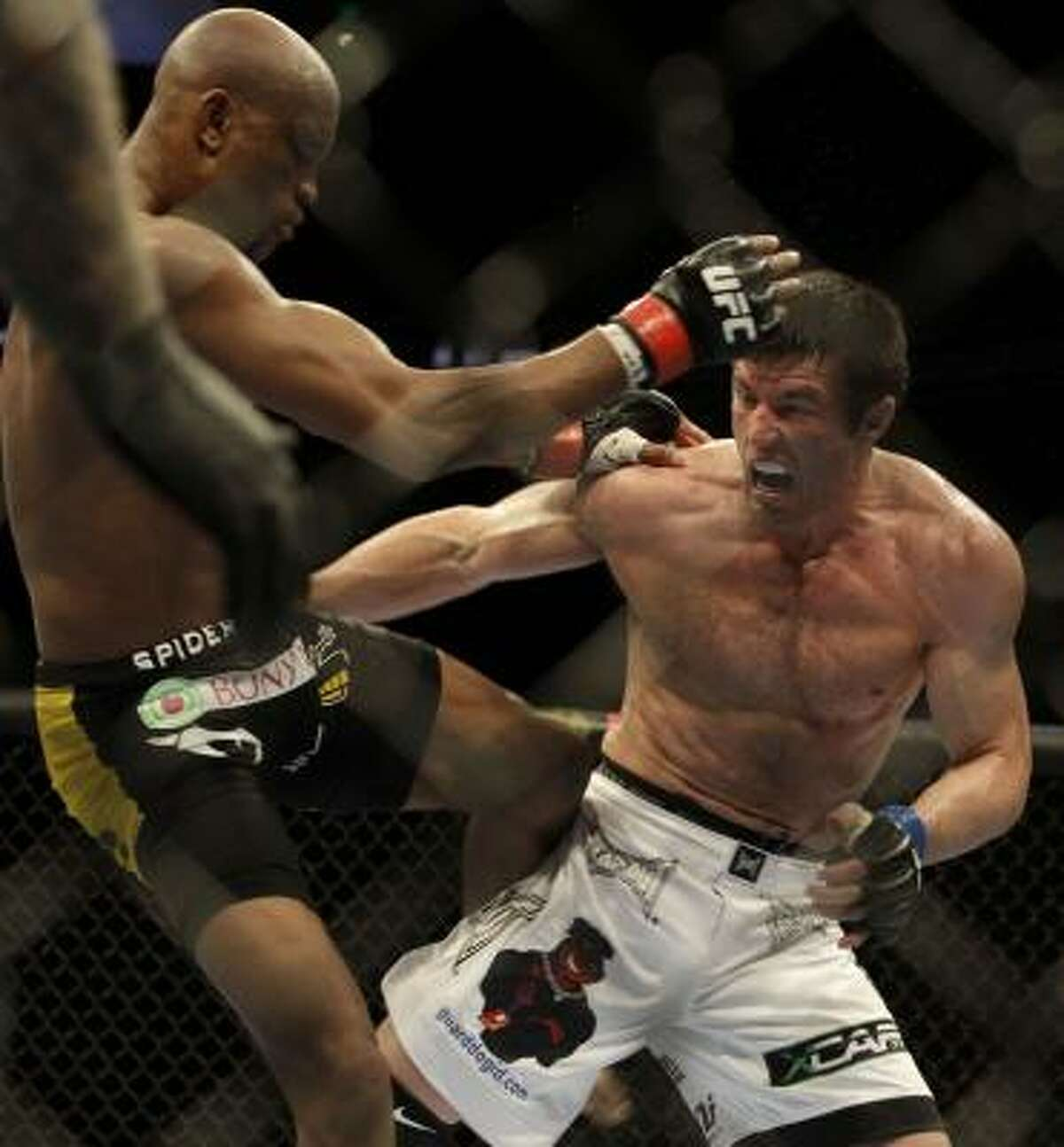 Anderson Silva, left, kicks Chael Sonnen during their middleweight title fight.