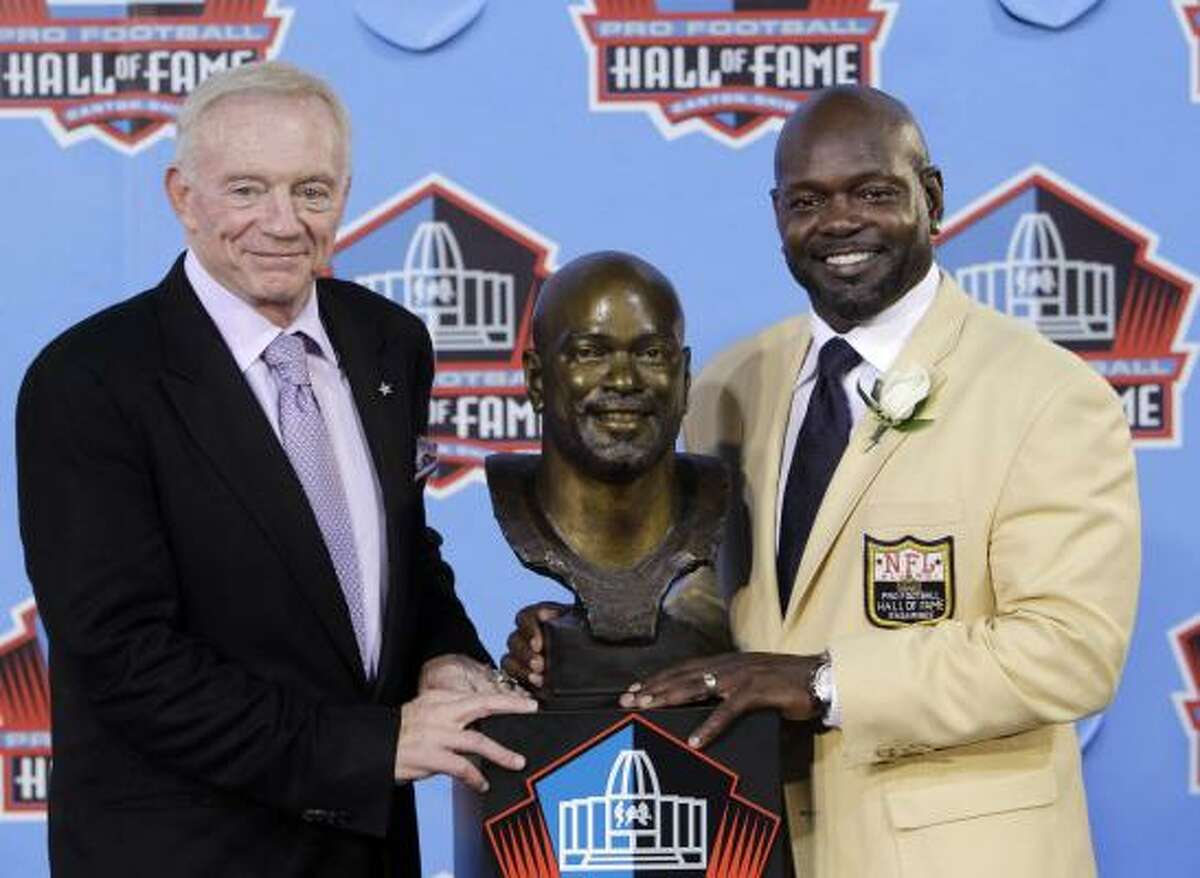 Former Cowboys great Emmitt Smith, right, poses with Cowboys owner Jerry Jones after Smith's enshrinement in the Pro Football Hall of Fame on Saturday in Canton, Ohio. Smith retired as the NFL's all-time leading rusher.