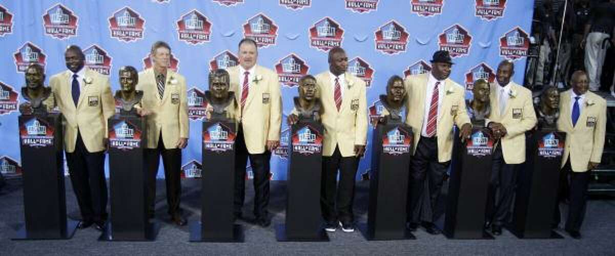 Members of the 2010 Pro Fotball Hall of Fame class, which includes (from left) Emmitt Smith, Dick LeBeau, Russ Grimm, John Randle, Rickey Jackson, Jerry Rice and Floyd Little, pose with their busts after the enshrinement ceremony.