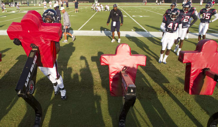 Bernard Pollard takes on the blocking sled during a drill at the open practice. Photo: Brett Coomer, Chronicle