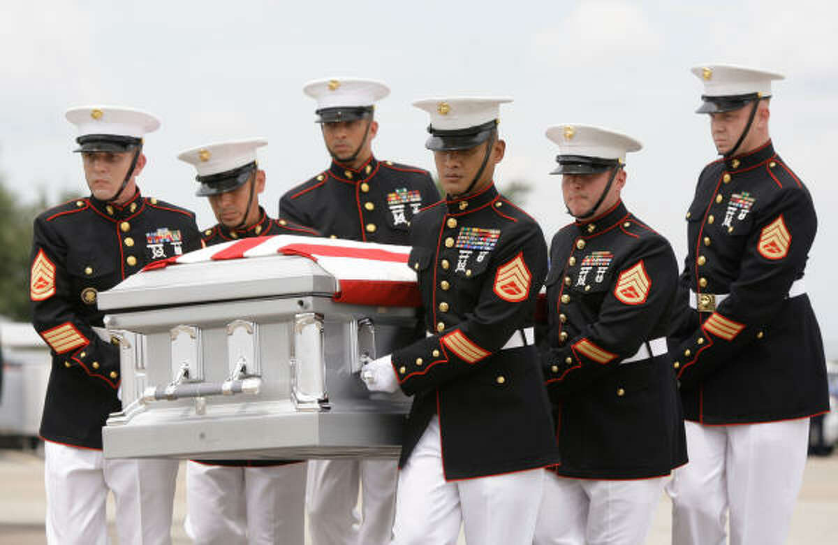 Marines carry the casket of Lance Cpl. Shane R. Martin of Spring to the hearse after it's arrival at a private charter service at Bush Intercontinental Airport in Houston. He was a member of 1st Light Armored Reconnaissance Battalion, 1st Marine Division, I Marine Expeditionary Force.