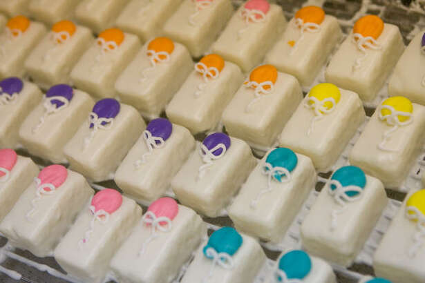 Petits fours are a signature item at Moeller's Bakery, which will celebrate its 80th anniversary on August 14.