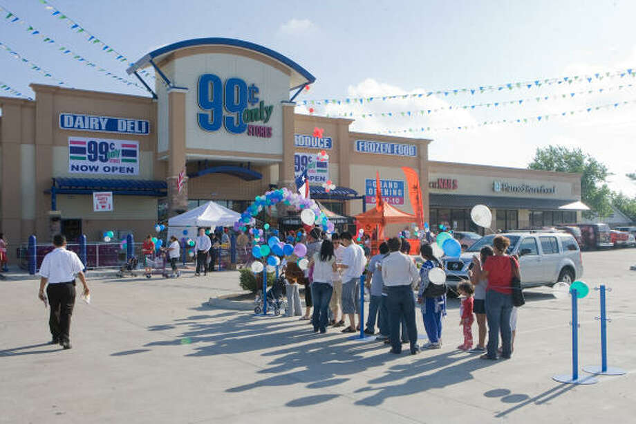 Shoppers line up across the parking lot and down the sideway for the Grand Opening Celebration for the new 99 Cents Only store on Bellaire. Photo: R. Clayton McKee, For The Chronicle