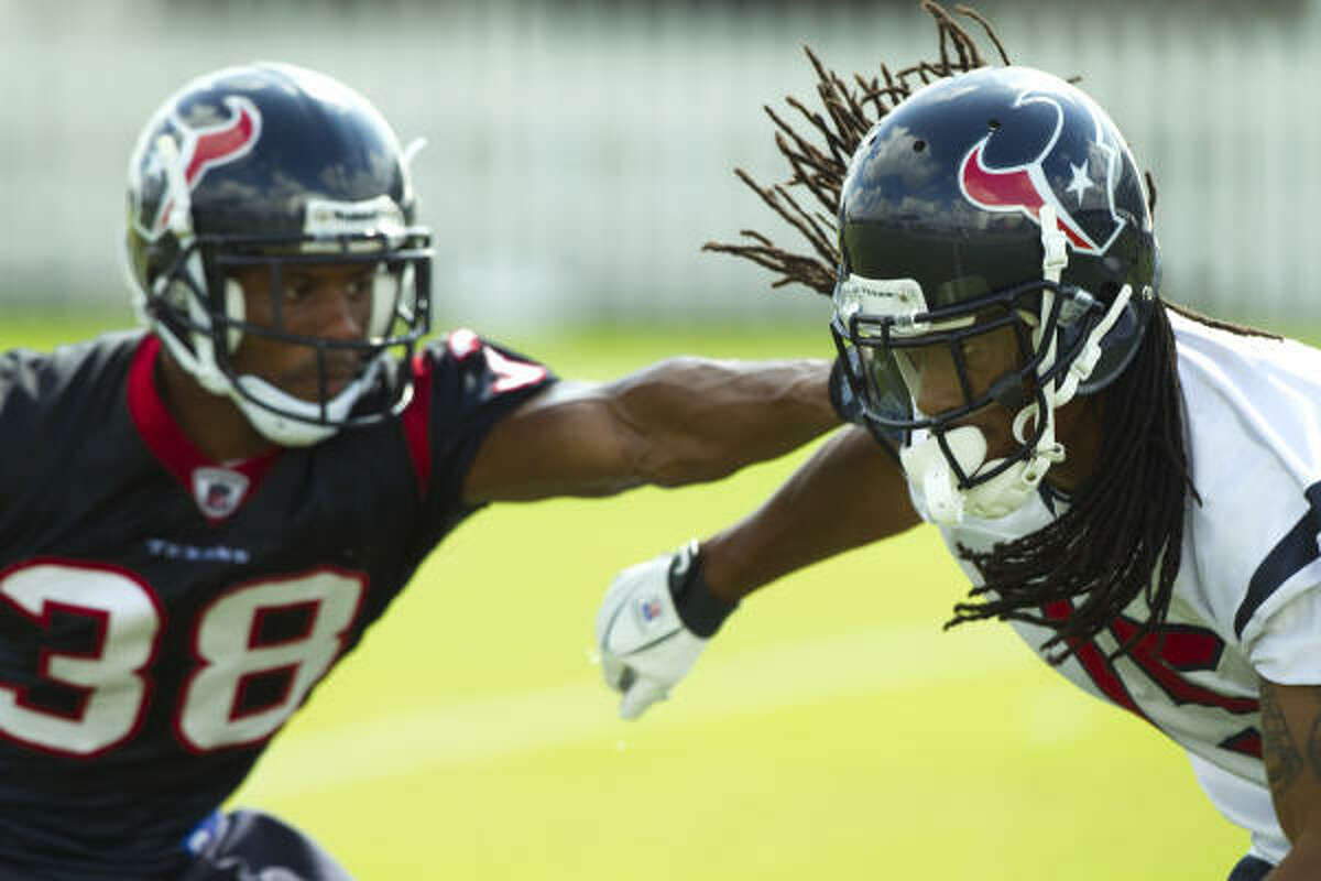Texans cornerback Mark Parson (38) covers wide receiver Bobby Williams as he runs downfield to defend a punt.