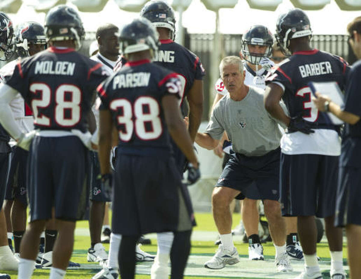 Texans special teams coach Joe Marciano works with the punt unit during practice.
