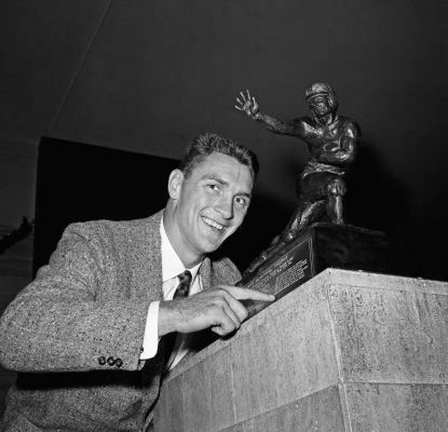 1959: Billy Cannon  School: LSU  Position: Running back  Class: Senior  Photo: Jacob Harris, AP