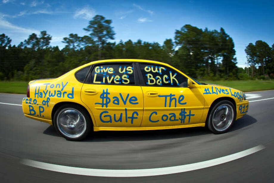 "A driver rolls down the highway with messages such as ""$ave the Gulf Coa$t""  and ""Tony Hayward C.E. O of B.P. Give us out Live Back"" while driving Pensacola, FL. Photo: Smiley N. Pool, Chronicle"