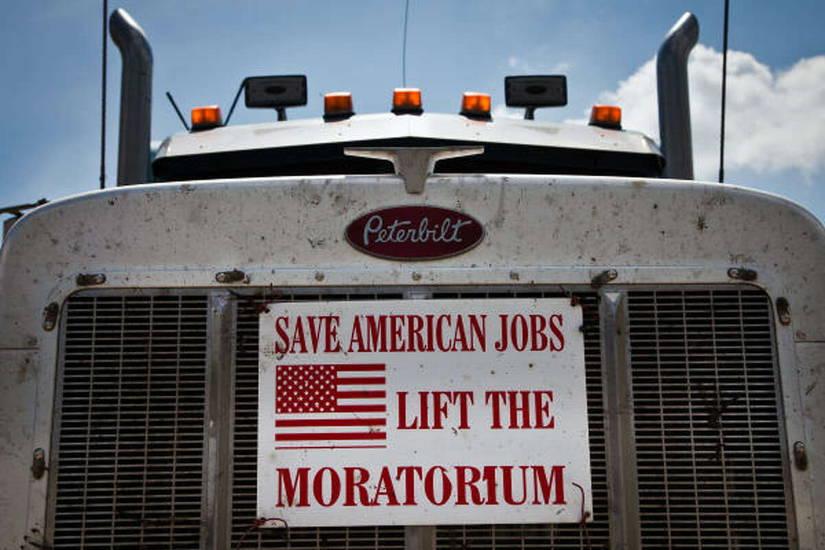 A sign on the front grill of an 18-wheeler at a truck stop expresses frustration with the drilling moratorium in Cut Off, La.