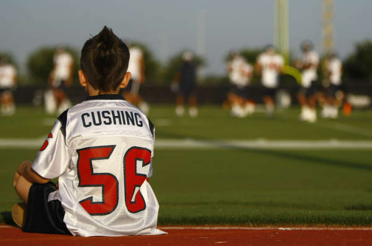 Luke Husband, 7, of Spring, watches the Aug. 3 morning workout as part of TORO's Kids Club.