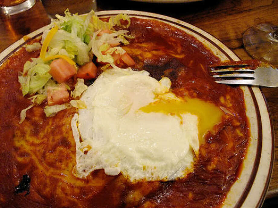 Stacked red-chile and cheese enchiladas at The Shed in Santa Fe, with an over-easy egg on top.  So good I ordered 2 platefuls. Photo: Alison Cook, Chronicle