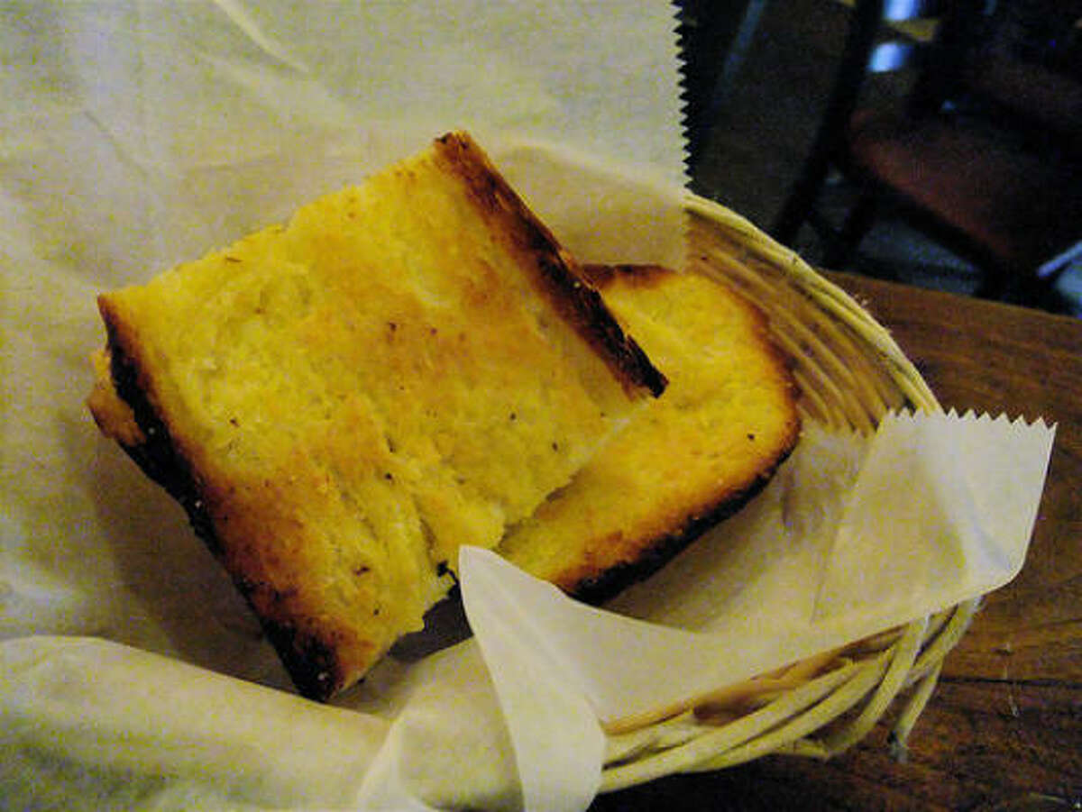Garlic bread is the traditional sop for red chile at The Shed in Santa Fe--and it's surprisingly effective.