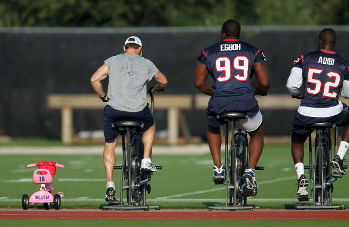 Texans wide receiver Trindon Holliday's kid's pink tricycle sits between the stationary bikes for players.