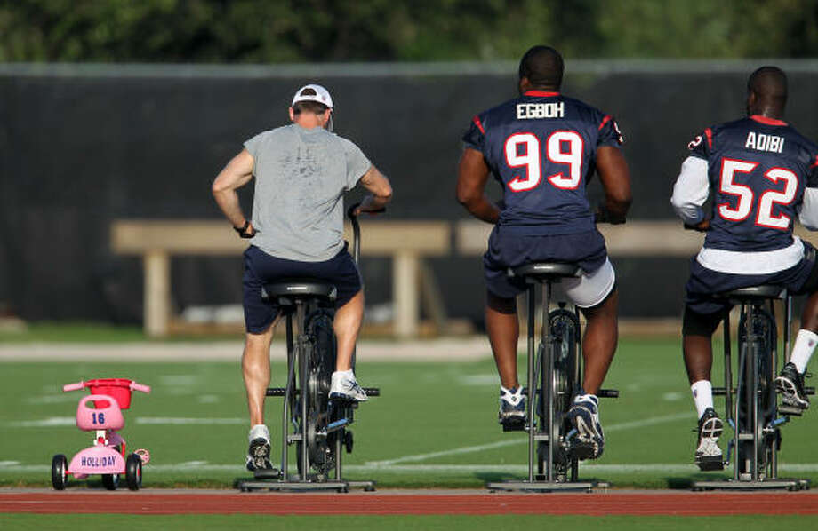 Texans wide receiver Trindon Holliday's kid's pink tricycle sits between the stationary bikes for players. Photo: Karen Warren, Chronicle