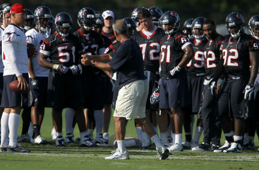 Texans special teams coordinator Joe Marciano goes over some plays at training camp.
