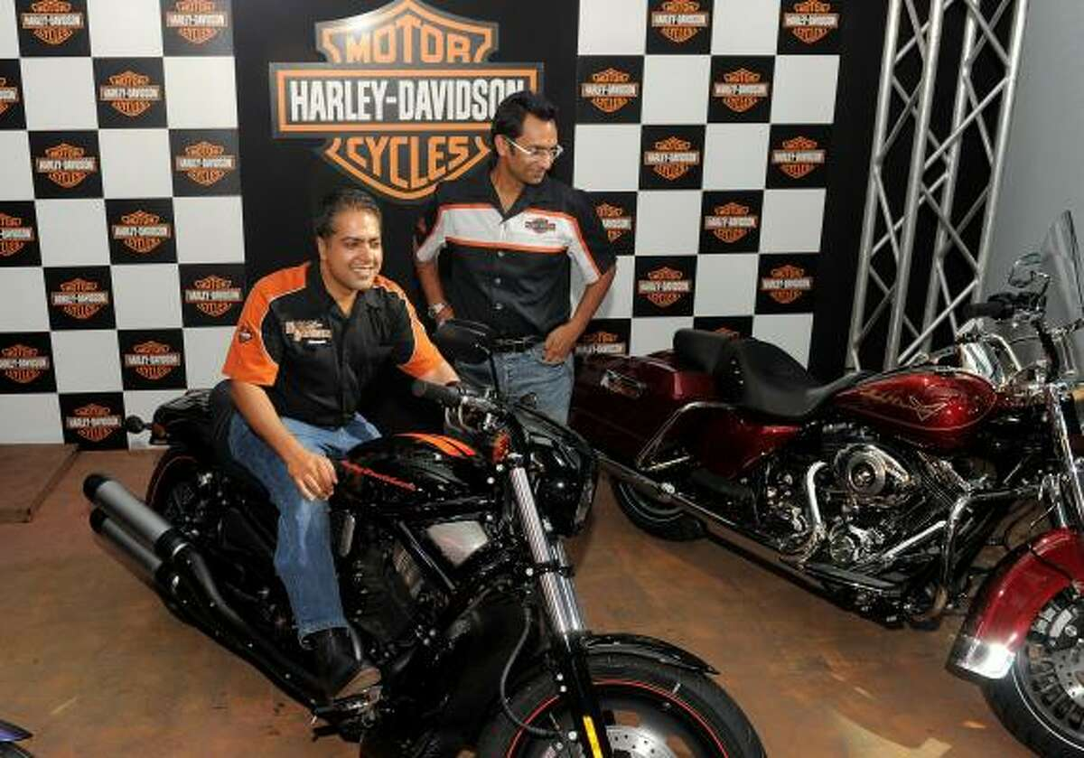 NEW DELHI, INDIA : Managing Director Harley-Davidson India Anoop Prakash, left, poses with Managing Director Capital Harley-Davidson Atul Aggarwal during the inaugration of Harley Davidson's dealership in New Delhi on July 14, 2010. The newly inaugrated Capital Harley-Davidson dealership will offer the entire 2010 Harley-Davidson India line-up of 12 motorcycles in addition to the brand's authentic riding gear and merchandise.