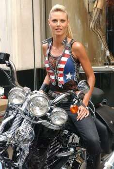 HEIDI KLUM: Model Heidi Klum pose with a Harley- Davidson motorcycle during the introduction of the new Rock Angel Collection at Victoria's Secret 34th St. flagship store in New York, Tuesday, July 22, 2003. Photo: STEPHEN CHERNIN, AP
