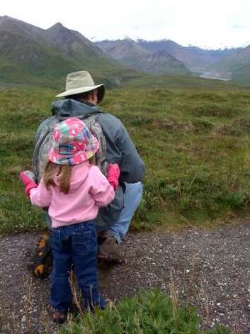 "Hazel ""helps"" Papoux on the hiking trail in Denali National Park. Photo: Nicki Britton, Chronicle"