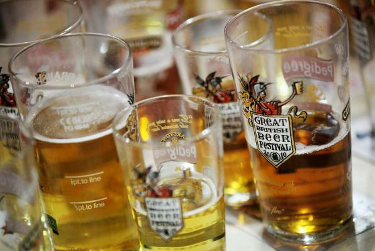 Half-drunk pint glasses are placed on a table at the 'Great British Beer Festival 2010' in Earls Court exhibition centre on Aug. 3, 2010, in London. The 5-day event is Britain's largest beer festival with more than 60,000 people expected to attend.