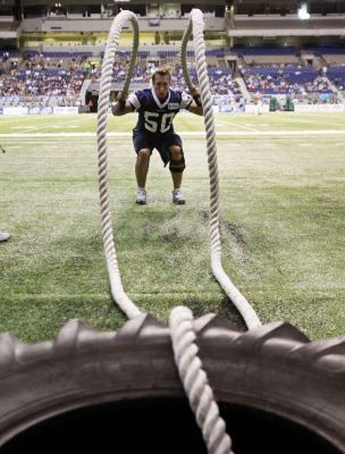 Dallas Cowboys' Sean Lee works with heavy ropes during the team's NFL football training camp, Tuesday, Aug. 3, 2010, in San Antonio.