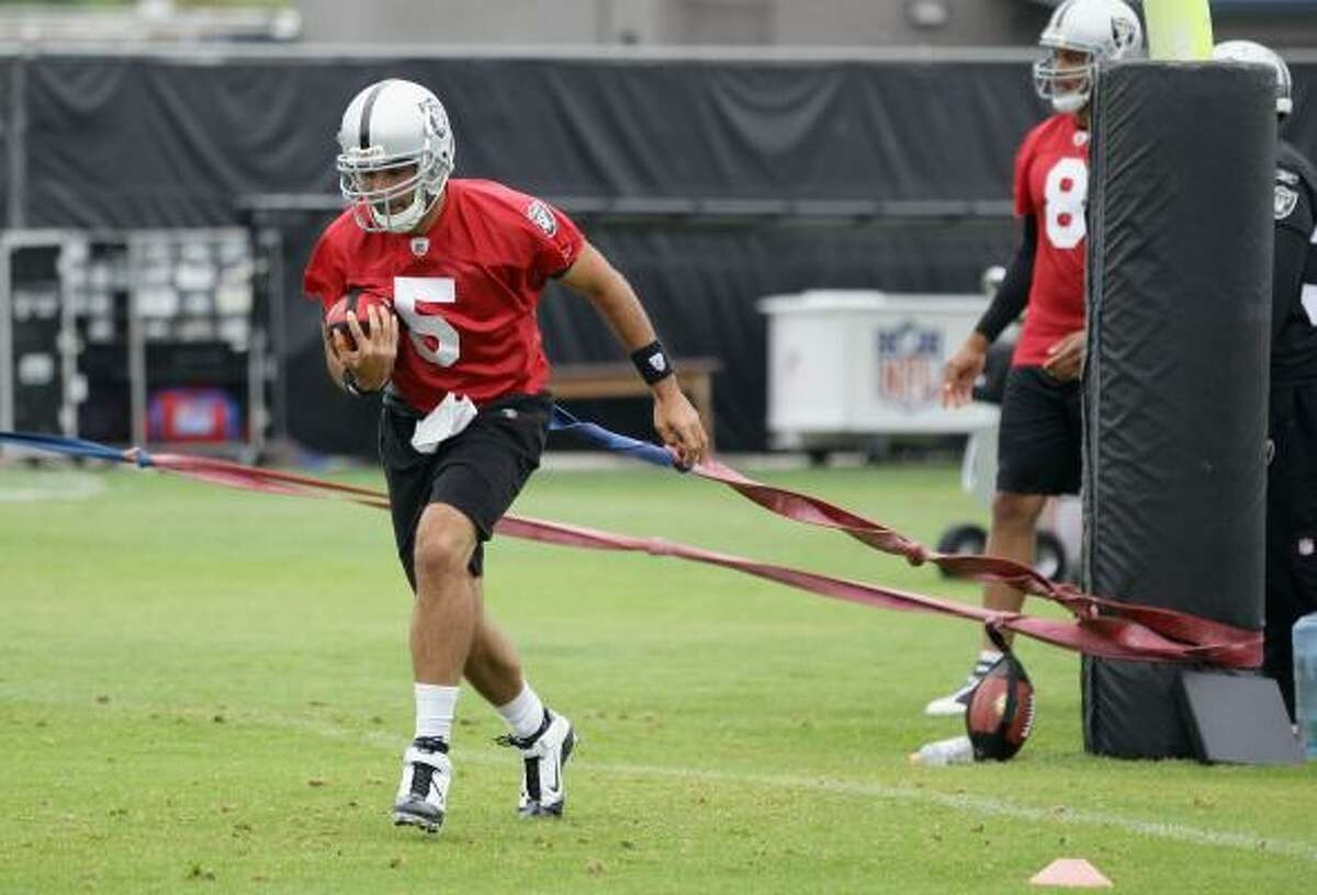 NAPA, CA - AUGUST 01: Bruce Gradkowski #5 of the Oakland Raiders works out during the Raiders training camp at their Napa Valley Training Complex on August 1, 2010 in Napa, California.
