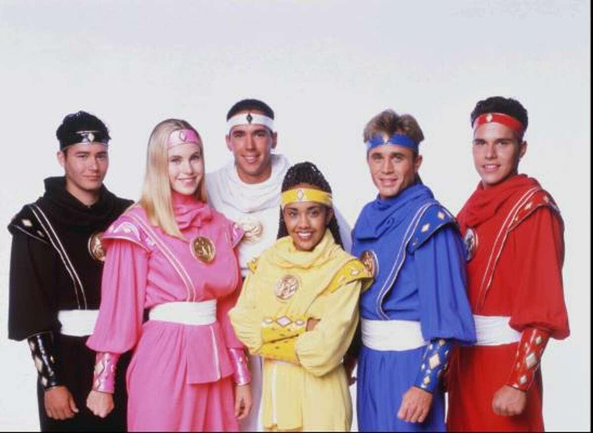 A group shot of the Power Ranger's cast highlights Jason David Frank.