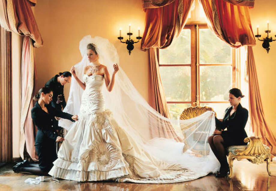 When Melania Knauss wed billionaire developer Donald Trump, it was expected to be a fancy, expensive event. The two did not disappoint.  Knauss wore a $100,000 wedding gown made from 300 feet of crystal-beaded satin and a 13-foot train weighing an estimated 50 pounds. Photo: Mario Testino, VOGUE