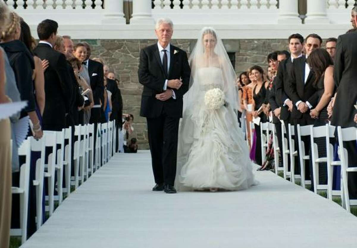 Former President Bill Clinton escorts Chelsea down the aisle in Rhinebeck, N.Y.