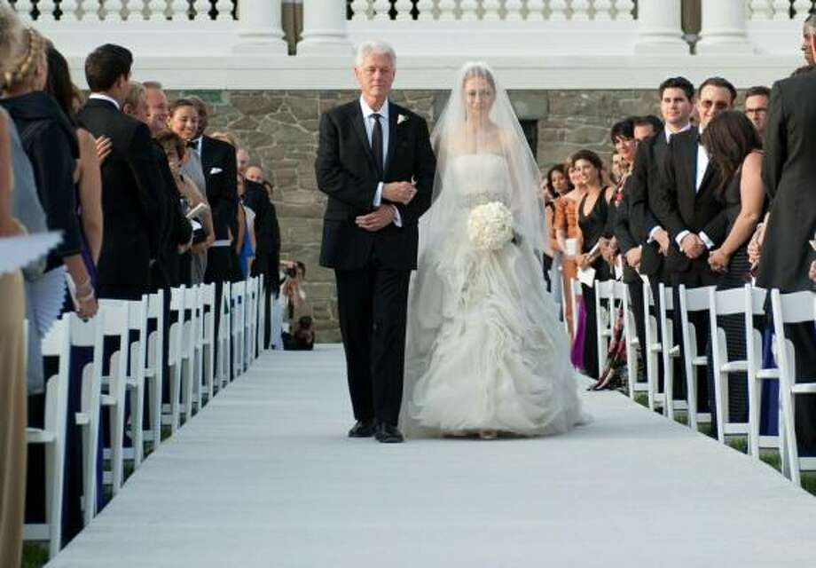 Former President Bill Clinton escorts Chelsea down the aisle in Rhinebeck, N.Y. Photo: GENEVIEVE DE MANIO, AFP/Getty Images
