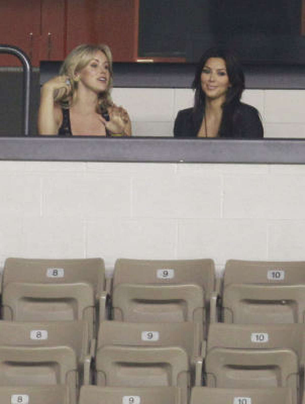 Candice Crawford, left, and Kim Kardashian, right, attend the Dallas Cowboys training camp.