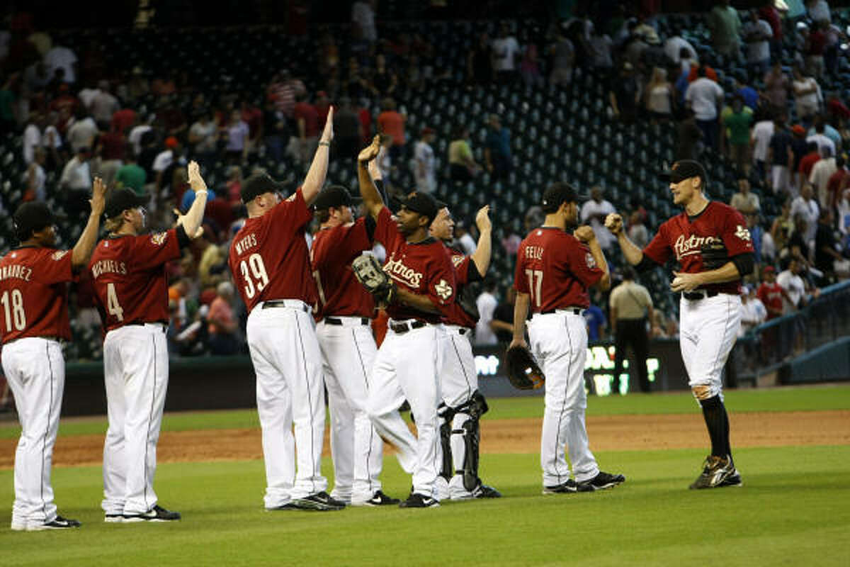 The Astros celebrate their 5-2 victory over the Milwaukee Brewers, giving them the series sweep and a five-game winning streak.