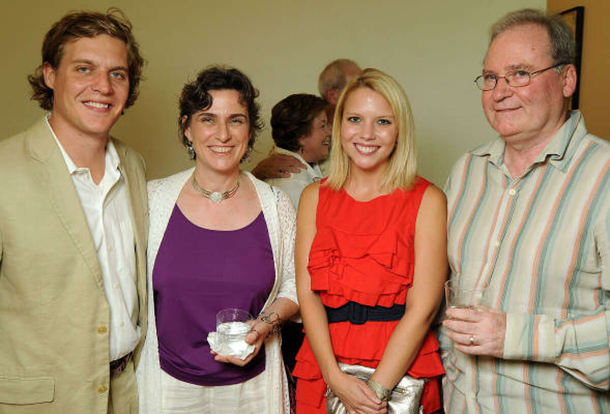 From left: Adam Faust, Maxine Lennon, Piper Faust and Matthew Lennon at a private reception for artist Dennis Oppenheim's new exhibit Radiant Fountains at Devin Borden Hiram Butler Gallery.