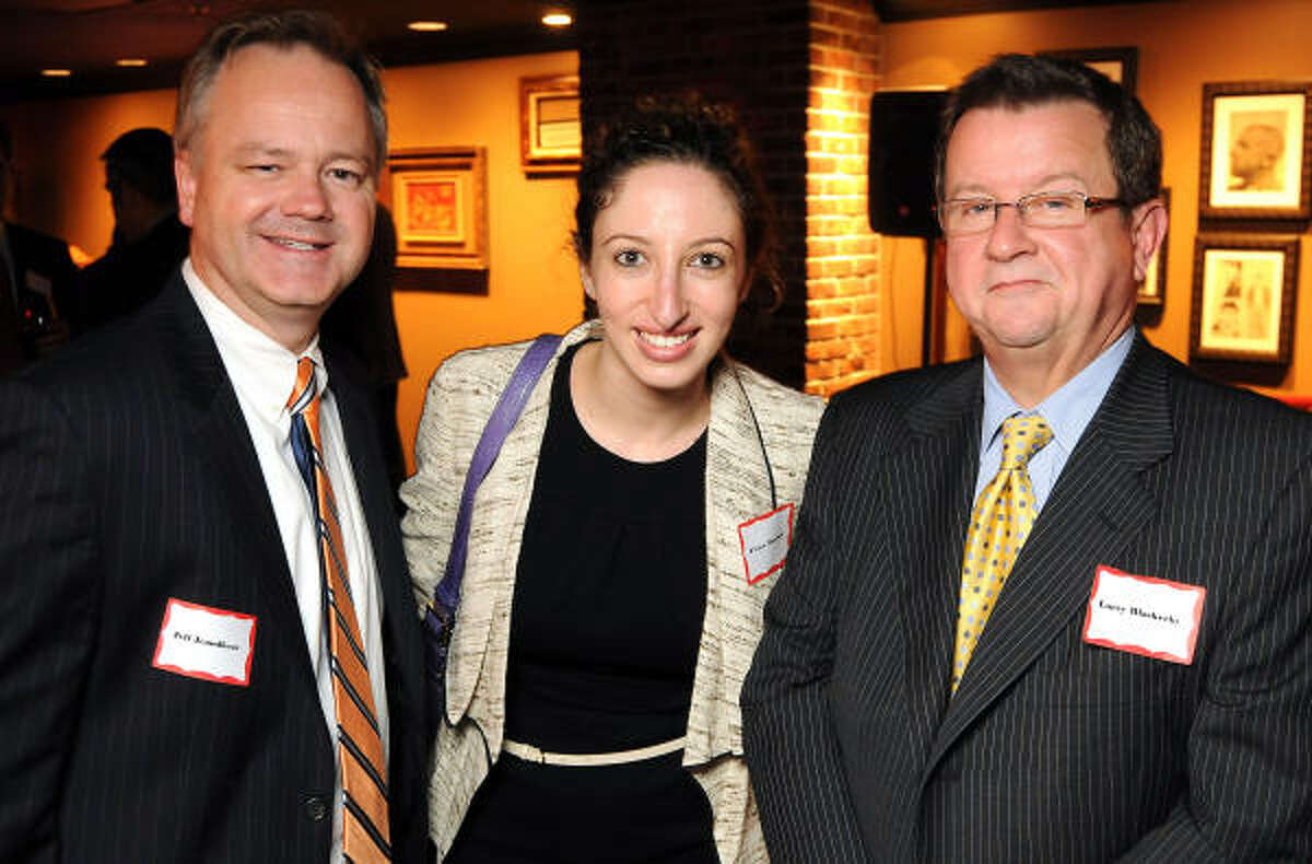 From left: Jeff Jeandheur, P'nina Mossman and Larry Blackerby at the Muscular Dystrophy Association's Elite 50 speakeasy party at the Hotel ZaZa.